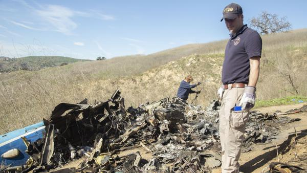 National Transportation Safety Board examine wreckage on Jan. 27 of the crash that killed NBA star Kobe Bryant and eight other people near Calabasas, Calif.