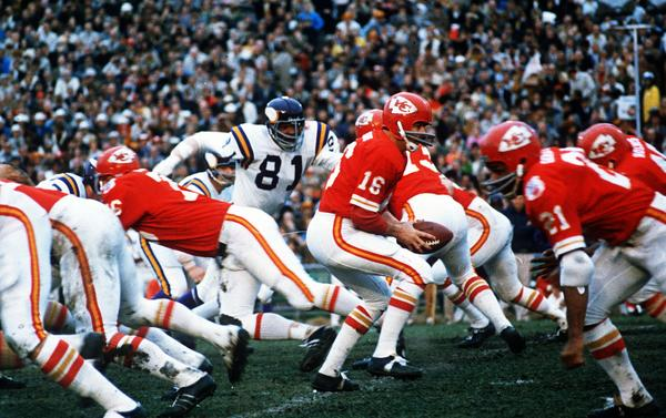 Kansas City Chiefs quarterback Len Dawson (16) turns around to hand the ball off to running back Mike Garrett (21) during the Super Bowl IV football game in New Orleans.