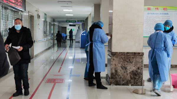 Medical staffs sterilize the main building of Jinyintan Hospital on Jan. 22 in Wuhan, China. A 60-year-old who died at the hospital on Thursday is the first American known to have died after being infected by the coronavirus.