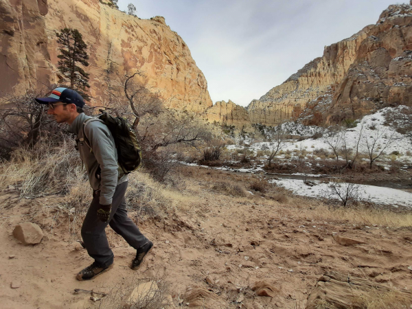 Jonathan Paklaian hikes along the banks of a river flowing through Grand Staircase-Escalante National Monument, which was downsized by the Trump administration in 2017. A final management plan for the area was released in early February.