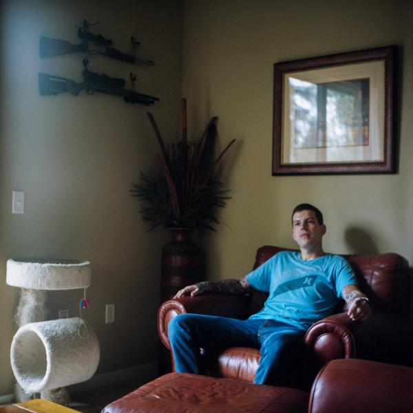 Josh Haggard sits for a portrait in his living room on Jan. 24, 2020, in Wilsonville, Ore. Haggard's mom, worried that her son might hurt himself, petitioned a judge to have his guns taken away.