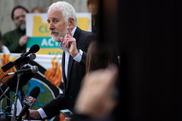 <p>Milwaukie Mayor Mark Gamba speaks during a rally for climate action at the Capitol in Salem, Ore., Feb. 11, 2020.&nbsp;Milwaukie declared a climate emergency earlier in the year.</p>