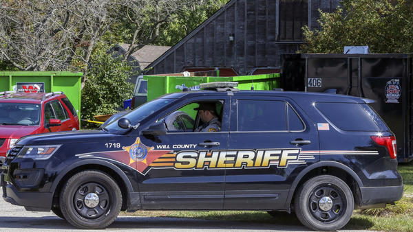 A patrol car is stationed outside the home of deceased Ulrich Klopfer in Crete, Ill., on Sept. 19, 2019. Indiana Attorney General Curtis Hill presided over the mass burial Wednesday of the remains of more than 2,400 fetuses found last year at the suburban Chicago home of Klopfer, one of the Midwest's most prolific abortion doctors.
