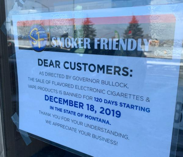 A sign on at a Montana vape shop tells customers that the sale of flavored vape products has been temporarily banned by the governor.