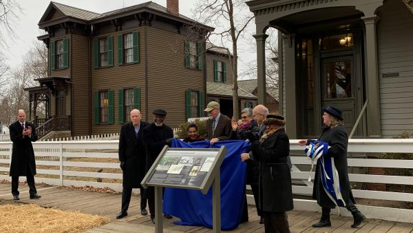 Members of the Springfield Rosenwald Initiative unveil a plaque commemorating the philanthropist, who funded thousands of schools in the segregated south.