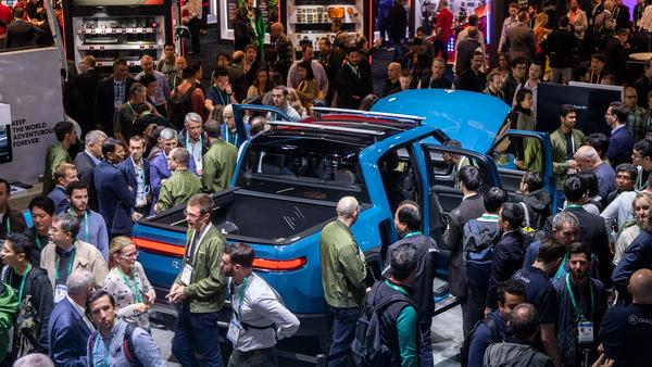 The Rivian R1T pickup is surrounded by onlookers at CES in Las Vegas in January.