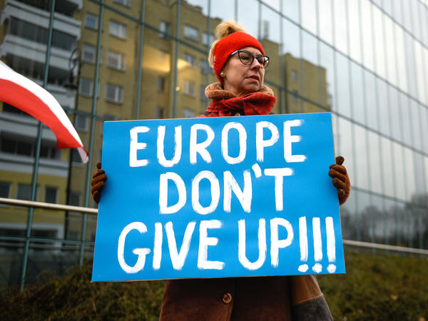 A pro-democracy protestor holds a placard ahead of a meeting between the Vice President of the European Commission for Values and Transparency, Vera Jourova, and the First President of Poland's Supreme Court, Malgorzata Gersdorf, in front of the Supreme Court on Jan. 28 in Warsaw. European Commission officials were in Poland for talks regarding controversial judicial reforms.