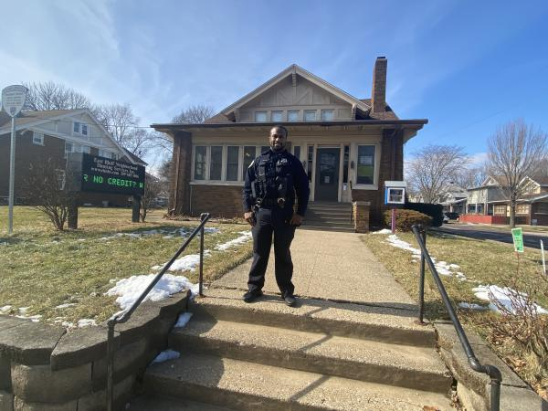 Officer Jerry James, Jr. stands outside of his residence at 1839 N. Wisconsin Ave.