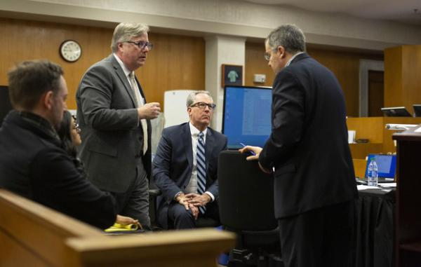 <p>Defense attorney Greg Scholl (left) and prosecutors Don Rees and Jeff Howes discuss legal matters before a recess at the Multnomah County Courthouse on Feb. 13, 2020, day 11 in the trial of Jeremy Christian for the stabbing of three people on a MAX train in Portland in May 2017.</p>