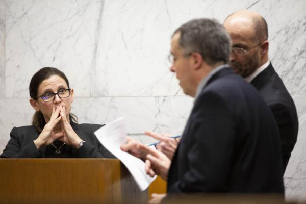 <p>Defense attorney Dean Smith and prosecutor Jeff Howes discuss records shown to Portland police detective Michele Michaels during her testimony at the Multnomah County Courthouse on&nbsp;Feb. 13, 2020, day 11 in the trial of Jeremy Christian for the stabbing of three people on a MAX train in Portland in May 2017.</p>