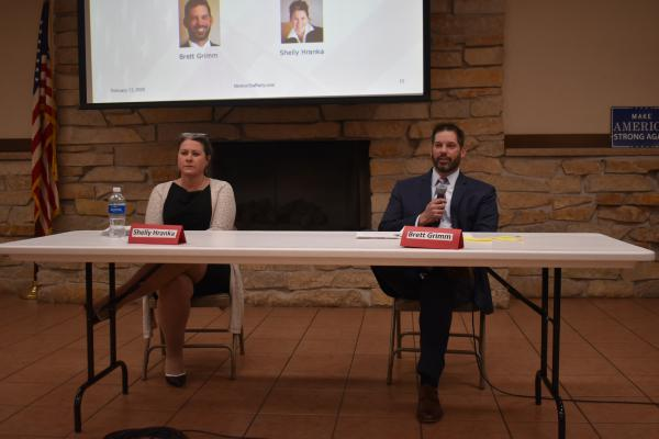 Tazewell County Auditor Shelly Hranka (left) and candidate Brett Grimm at a candidate forum Thursday night in Morton's Freedom Hall.
