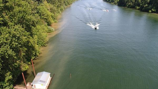 <p>An aerial image illustrates erosion along the bank of the Willamette River.</p>