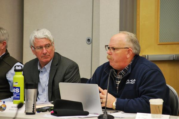 Montana Department of Natural Resources and Conservation Director John Tubbs, left, listens as Montana AFL-CIO Executive Secretary Al Ekblad urges fellow members of the Climate Solutions Council to address the impacts of greenhouse gas emission reductions