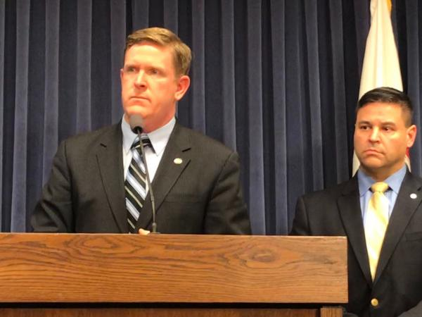 Illinois State Police Director Brendan Kelly speaking at a press conference alongside Deputy Director Isaiah Vega.