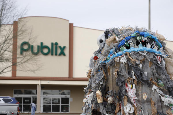 Greenpeace erects 15 foot plastic monster to shame Publix for using plastic bags.