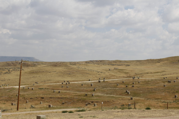 Tan boxes house injection and recovery wells at the Nichols Ranch in-situ mining operation in northeastern Wyoming.