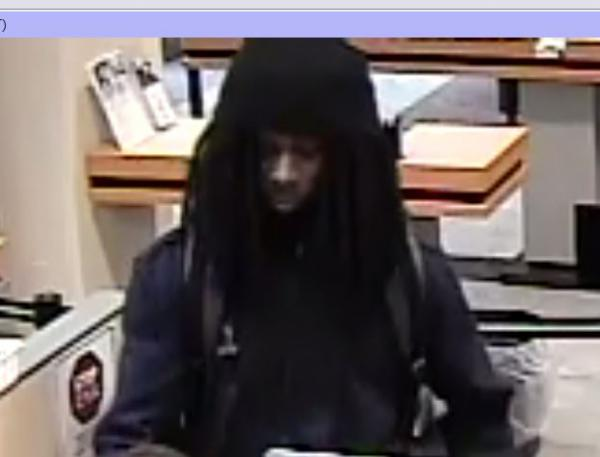 Security camera still from CEFCU of alleged robber