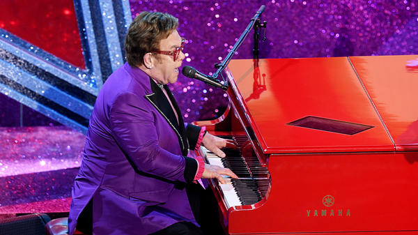 "Elton John performs at the Academy Awards on Feb. 9 in Los Angeles. He had to end a show in New Zealand early. He told his fans: ""I gave it all I had."""