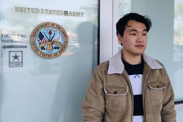 Seojun Lee stands outside an Army recruiting station near Phoenix. Lee signed up for the Army more than four years ago, but hasn't been allowed to serve.