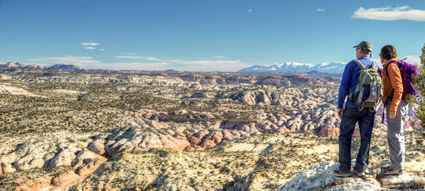 Two people admire a vista at the Grand Staircase Escalante National Monument, which the Trump administration shrunk by roughly half in 2017.