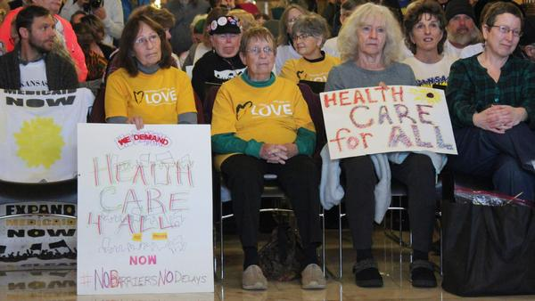 Medicaid expansion advocates attend a rally last month at the Kansas Statehouse.