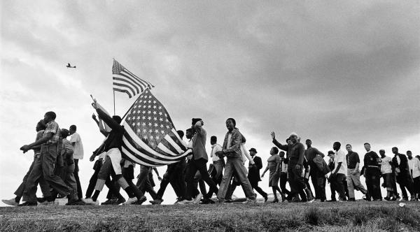 Maria Varela was one of nine photographers who worked for the Student Nonviolent Coordinating Committee. She took photos similar to this one, by colleague Matt Heron, which became iconic images of the 1960s civil rights movement.