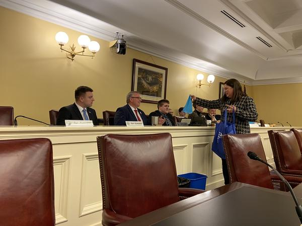Laura Jones, who chairs the citizens committee that works to pass levies in the Hudson City Schools, hands a bagged lunch to Rep. Don Jones (R-Freeport), who chairs the conference committee hearing the changes to EdChoice.