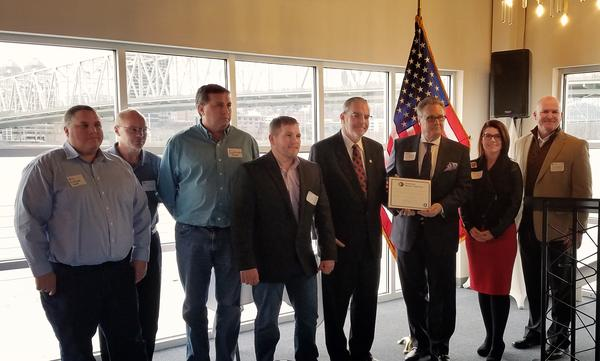 Local business owners and OKI authorities receive the Marine Highway designation from the federal Maritime Administration.