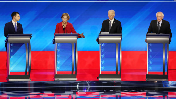 Amy Klobuchar and Michael Bloomberg join these four candidates — Pete Buttigieg (left), Elizabeth Warren, Joe Biden and Bernie Sanders — onstage Wednesday night.