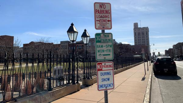 Some of the parking signs on Fifth Street downtown.