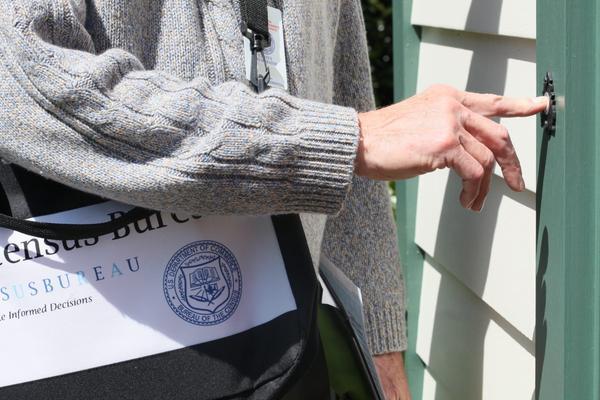 A U.S. Census worker goes door to door.