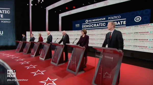 Seven Democratic candidates at the beginning of the PBS-Politico debate in December.