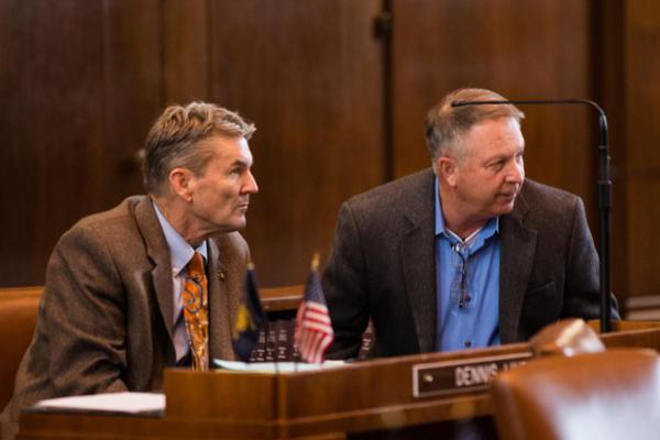<p>State Sens. Dennis Linthicum, R-Klamath Falls, and Herman Baertschiger Jr., R-Grants Pass, talk on the Senate floor at the Capitol in Salem, Ore., Thursday, April 11, 2019.</p>