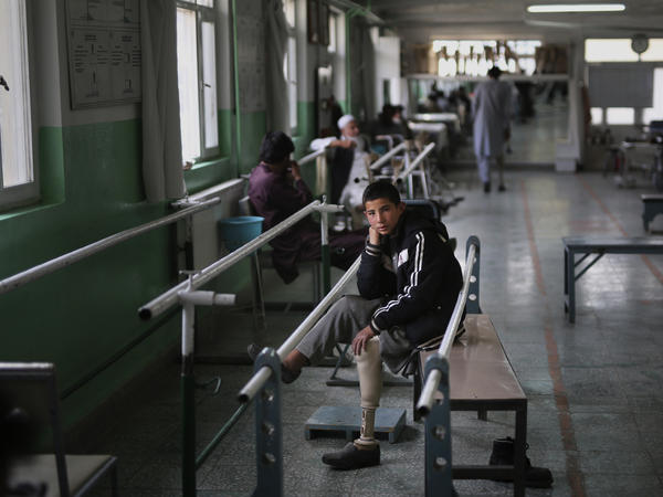 Abdullah, 13, lost his left leg when he stepped on an improvised explosive device. He takes a break from walking practice at the International Committee of the Red Cross physical rehabilitation center in Kabul on Dec. 1, 2019.