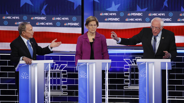 Former New York City Mayor Michael Bloomberg (left), Sen. Elizabeth Warren and Sen. Bernie Sanders participate in last week's Democratic presidential primary debate in Las Vegas.