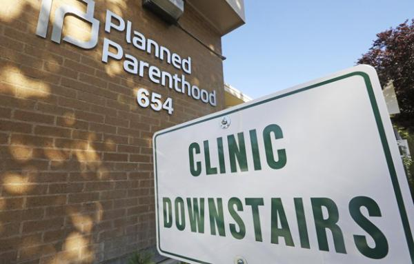 <p>A sign is displayed at Planned Parenthood of Utah Wednesday, Aug. 21, 2019, in Salt Lake City. About 39,000 people received treatment from Planned Parenthood of Utah in 2018 under a federal family planning program called Title X. The organization pulled out of the program rather than abide by a new Trump administration rule prohibiting clinics from referring women for abortions.</p>