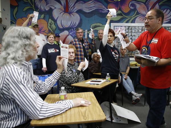 A precinct leader, right, counts votes at a caucus location at Coronado High School in Henderson, Nev., on Saturday.