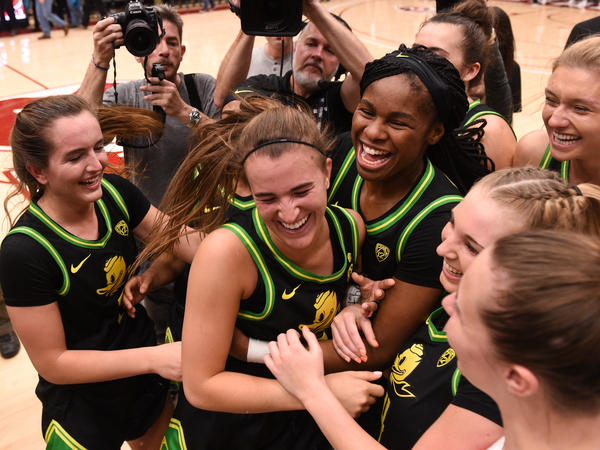 Oregon Ducks guard Sabrina Ionescu (center) celebrates with teammates after setting a triple-double milestone against Stanford on Monday in Palo Alto, Calif.
