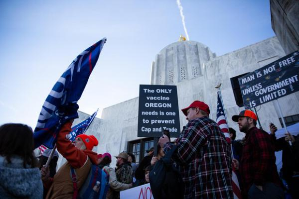 People hold signs at a Timber Unity rally in front of the Oregon Capitol in Salem, Ore., Thursday, Feb. 6, 2020.
