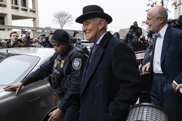 Roger Stone, center, departs federal court in Washington on Thursday.