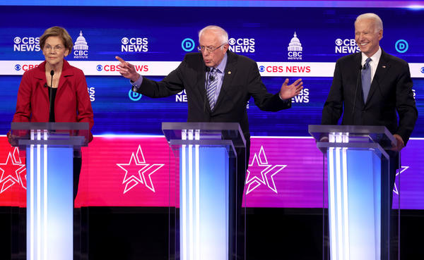 From left: Presidential candidates Sen. Elizabeth Warren, D-Mass., Sen. Bernie Sanders, I-Vt., and former Vice President Joe Biden participate in the Democratic debate.