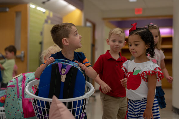 A child grabs his backpack on his first day of preschool at the Affton Early Childhood Center on Aug. 13, 2019.