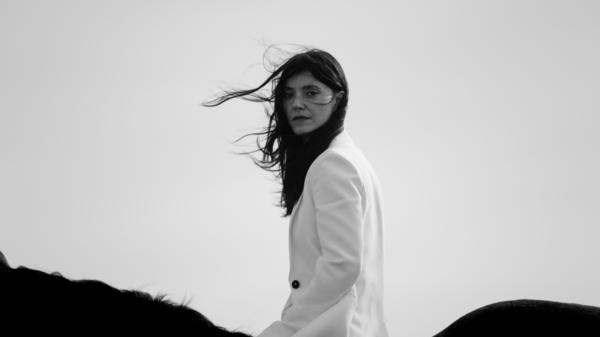 "Sharon Van Etten astride a horse for her ""Beaten Down"" video."