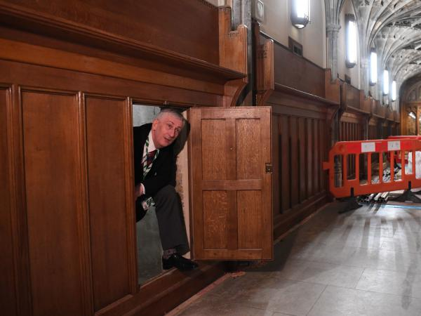Speaker of the U.K. House of Commons Lindsay Hoyle emerges from a chamber concealing a 360-year-old passageway that was rediscovered during renovation work in the Houses of Parliament in London.