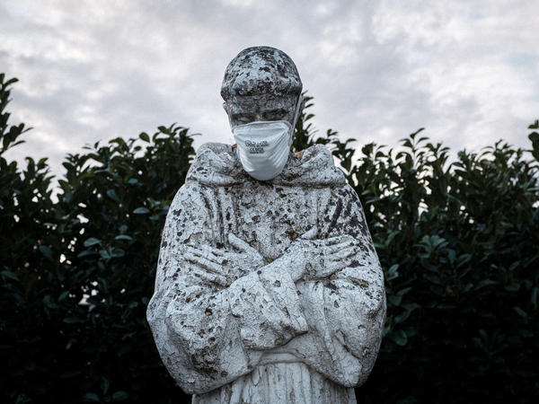 A face mask adorns a statue of St. Francis of Assisi in the town of San Fiorano, one of the places in Italy on lockdown due to the novel coronavirus outbreak. The picture was taken by schoolteacher Marzio Toniolo.