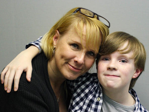 Jennifer Sumner and her son, Kaysen Ford, embrace at their StoryCorps interview in 2015 in Birmingham, Ala.