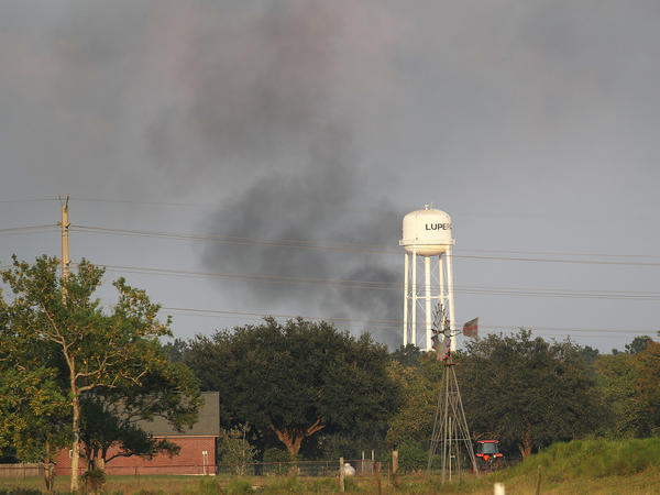 Smoke from chemical fires at a Houston-area facility owned by the company Arkema, which flooded during Hurricane Harvey in 2017. Trailers and storage containers that burned in the fires released soot and other air pollution.