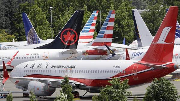 Grounded Boeing 737 Max airplanes crowd a parking area in Seattle in June.