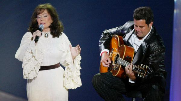 Loretta Lynn (left) and Vince Gill perform together in 2004. Writer Marissa Moss cites Lynn as an example of a progressive thinker in country music.