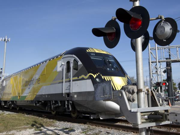A Brightline train approaches a railroad crossing on Jan. 18, 2018, in Fort Lauderdale, Fla. In its first two years, more than 40 people have been killed by Brightline trains on tracks and at rail crossings.
